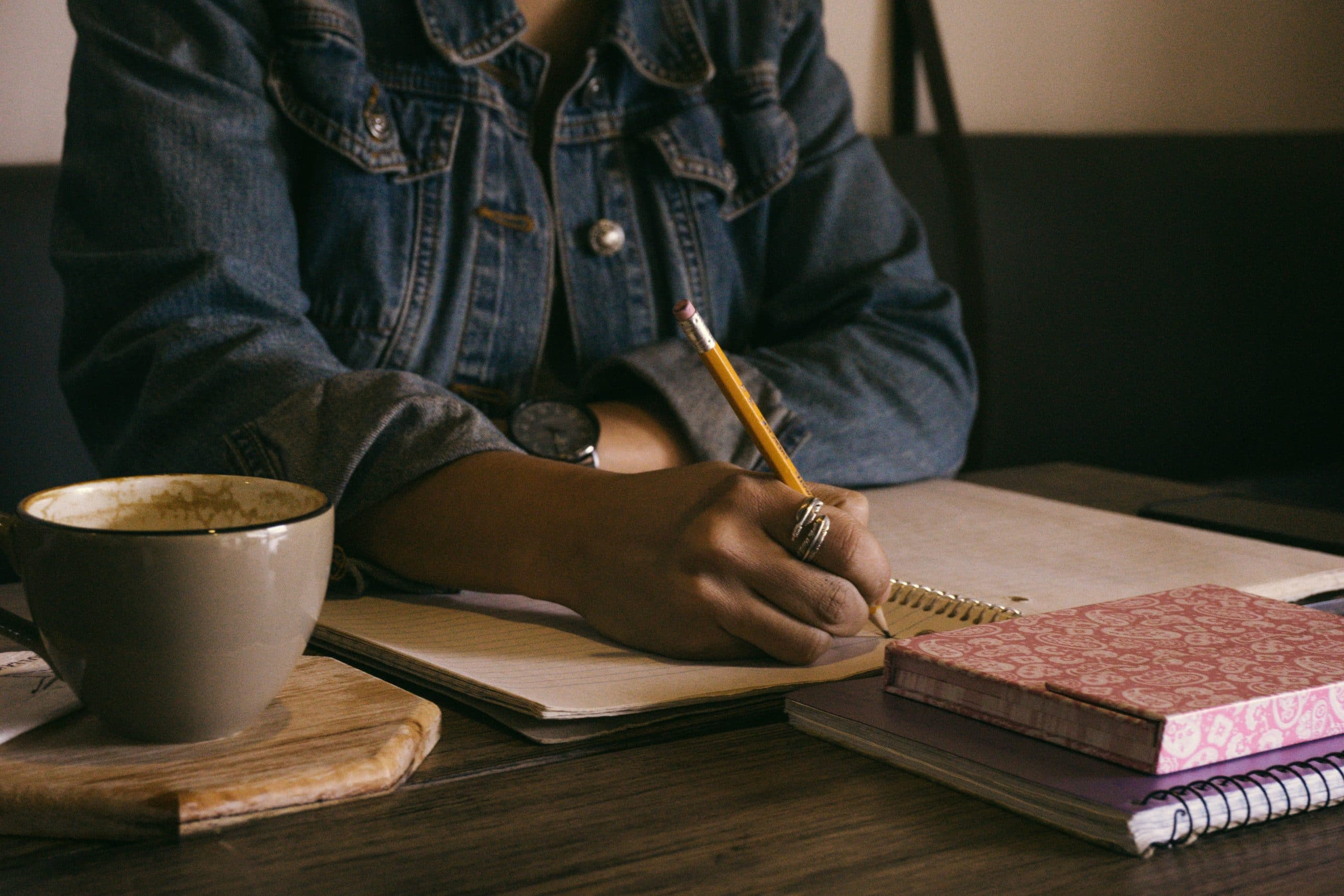 Write for the Ability Toolbox. Image: African-American woman writing in notebook.